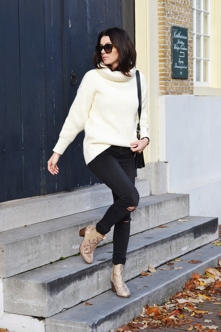 You can never go wrong with a cream knitted sweater!