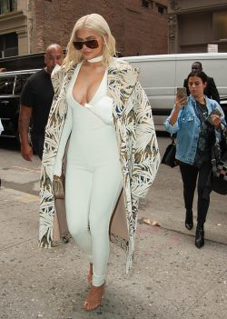 Kylie Jenner shows off her cleavage in this plunging white jumpsuit in NYC